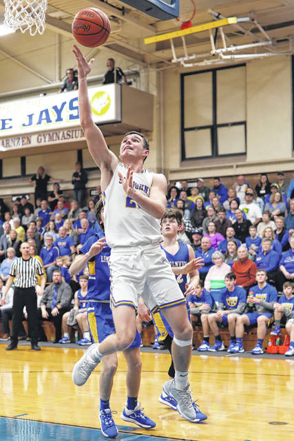 Brady Parrish of Delphos St. John's puts up a shot during Saturday night's game against Lincolnview in Delphos.