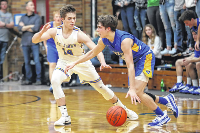 Aiden Rode of Delphos St. John's guards Lincolnview's Collin Overholt during Saturday night's game in Delphos.
