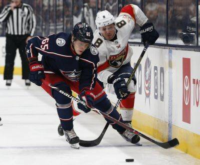 The Blue Jackets' Markus Nutivaara, left, and Florida's Jayce Hawryluk chase the puck during Tuesday night's game   in Columbus. AP photo