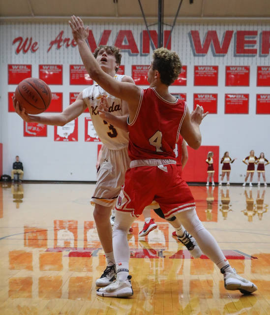 Kalida's Brandon Miller takes a shot against Patrick Henry's Clayton Feehand during the game at Van Wert High School on Wednesday.