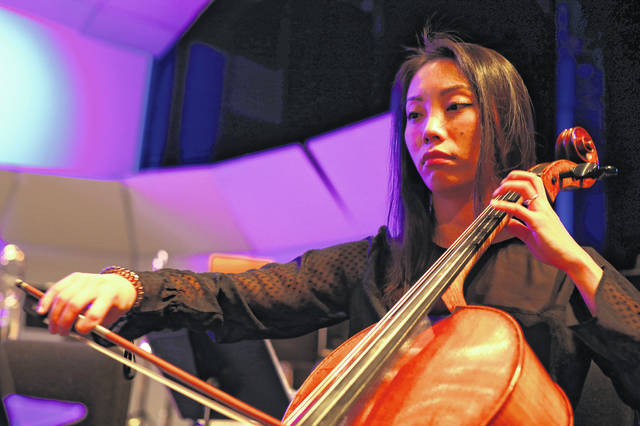 Xinya Zhou of Cincinatti practices her chello before The Lima Symphony Orchestra played Saturday evening. Amanda Wilson | The Lima News