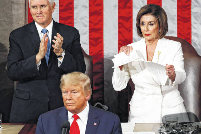 House Speaker Nancy Pelosi of Calif., tears her copy of President Donald Trump's s State of the Union address after he delivered it to a joint session of Congress on Capitol Hill in Washington on Tuesday. Vice President Mike Pence is at left. (AP Photo/Patrick Semansky)