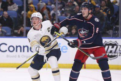 The Sabres' Jack Eichel, left, and Columbus' Zach Werenski (8) battle for position during Thursday night's game in Buffalo, N.Y. (AP photo)