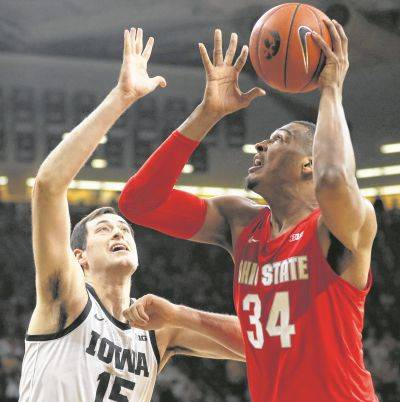 Ohio State's Kaleb Wesson (34) puts up a shot against Iowa's Ryan Kriener during Thursday night's game in Iowa City, Iowa.