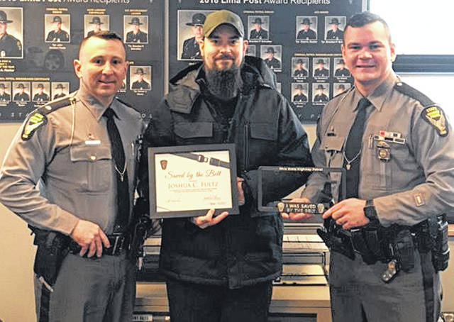 Pictured from left to right are Lt. Tim Grigsby, commander of the Lima post of the Ohio State Highway Patrol, Joshua Fultz and Trooper Chad Recker.