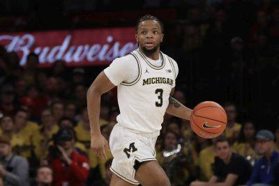 Michigan's Zavier Simpson, a Lima Senior graduate, reportedly crashed a vehicle prior to his one game suspension. AP photo