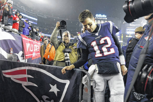 Quarterback Tom Brady leaves the field after New England lost 20-13 to Tennessee in a January NFL wild-card playoff game in Foxborough, Mass. Brady has reached a deal to play for Tampa Bay next season.