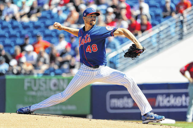 New York Mets pitcher Jacob deGrom throws during the first inning of a spring training baseball game against the Washington Nationals Sunday, March 1, 2020, in Port St. Lucie, Fla. (AP Photo/Jeff Roberson)