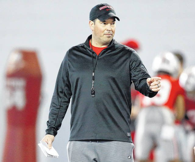 FILE - In this March 6, 2019, file photo, Ohio State University football coach Ryan Day gestures during an NCAA college football practice in Columbus, Ohio. Ohio State's spring practice likely will begin a competition to determine who will be the Buckeyes' starting quarterback in 2021. The contenders are highly touted freshmen Jack Miller or C.J. Stroud, both of whom were early enrollees and have been on campus since the beginning of the year. (AP Photo/Paul Vernon, File)