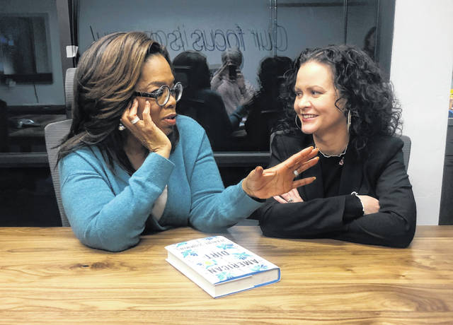 "Oprah Winfrey, left, and ""American Dirt"" author Jeanine Cummins appear in February in a conference room just above Modern Studios in Tucson, Ariz., where they taped an Oprah's Book Club show about Cummins' controversial book. The two-part interview will begin streaming on Apple TV Plus at midnight Friday."