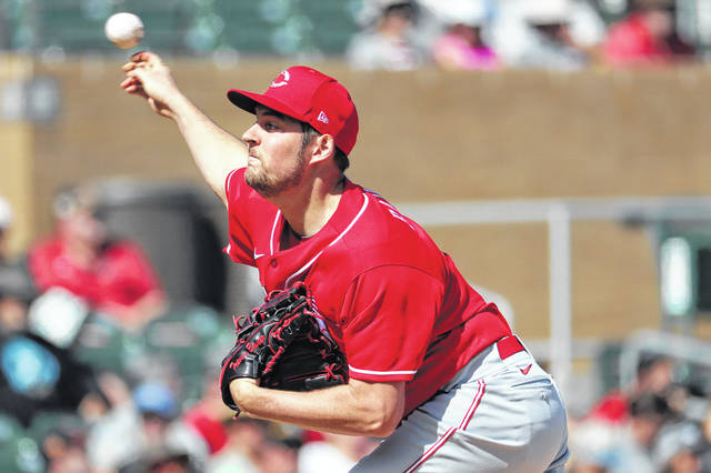 Cincinnati Reds pitcher Trevor Bauer throws against the Arizona Diamondbacks during the first inning of a spring training baseball game, Thursday, Feb. 27, 2020, in Scottsdale Ariz. (AP Photo/Matt York)