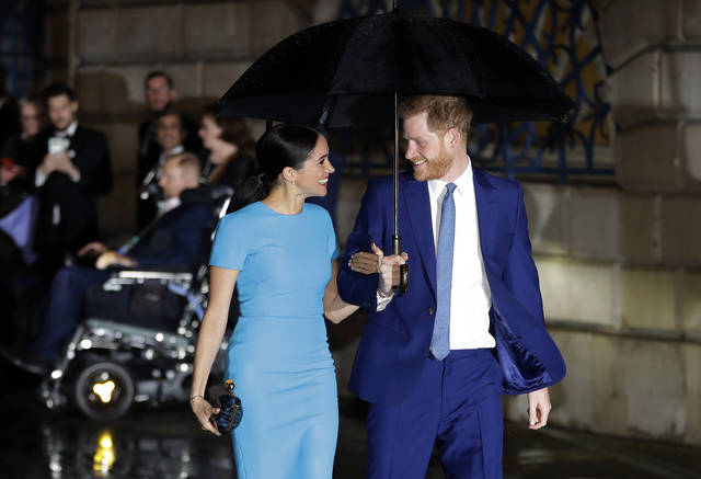 FILE - In this Thursday, March 5, 2020 file photo, Britain's Prince Harry and Meghan, the Duke and Duchess of Sussex arrive at the annual Endeavour Fund Awards in London. Prince Harry and his wife, Meghan, are fulfilling their last royal commitment Monday March 9, 2020 when they appear at the annual Commonwealth Service at Westminster Abbey. It is the last time they will be seen at work with the entire Windsor clan before they fly off into self-imposed exile in North America. (AP Photo/Kirsty Wigglesworth, file)