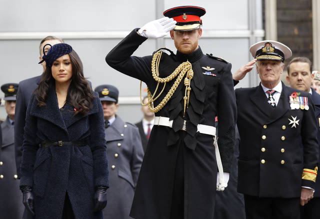 FILE - In this Thursday, Nov. 7, 2019 file photo, Britain's Prince Harry and Meghan, the Duchess of Sussex attend the 91st Field of Remembrance at Westminster Abbey in London. Prince Harry and his wife, Meghan, are fulfilling their last royal commitment Monday March 9, 2020 when they appear at the annual Commonwealth Service at Westminster Abbey. It is the last time they will be seen at work with the entire Windsor clan before they fly off into self-imposed exile in North America. (AP Photo/Kirsty Wigglesworth, file)