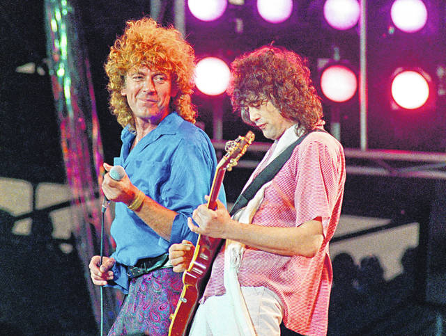 "In this July 13, 1985 file photo, Led Zeppelin bandmates Robert Plant, left, and guitarist Jimmy Page, reunite to perform for the Live Aid famine relief concert at JFK Stadium in Philadelphia. A federal appeals court on Monday restored a jury verdict that found Led Zeppelin did not steal ""Stairway to Heaven."""