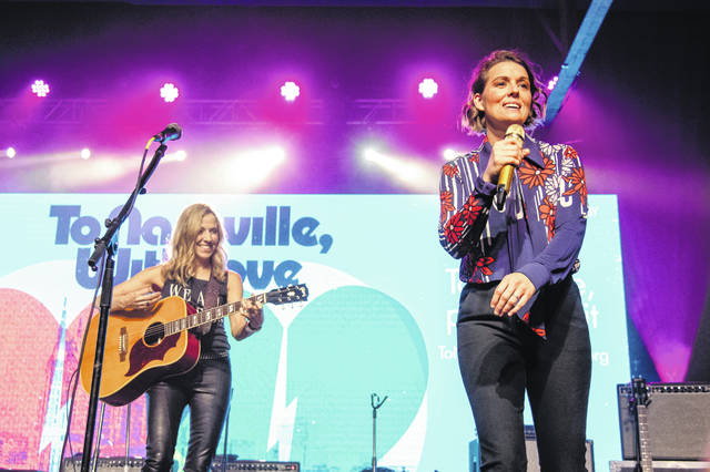 Sheryl Crow, left, and Brandi Carlile perform at the To Nashville, With Love Benefit Concert at Marathon Music Works on Monday in Nashville, Tenn.