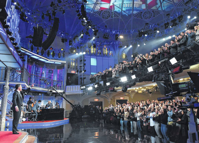 """Stephen Colbert, left, greeting the audience during a February taping of """"The Late Show with Stephen Colbert"""" in New York. The show, along with other New York-based late night talk shows """"The Tonight Show Starring Jimmy Fallon"""" and """"The Daily Show with Trevor Noah,"""" will tape their shows without studio audiences due to coronavirus concerns."""