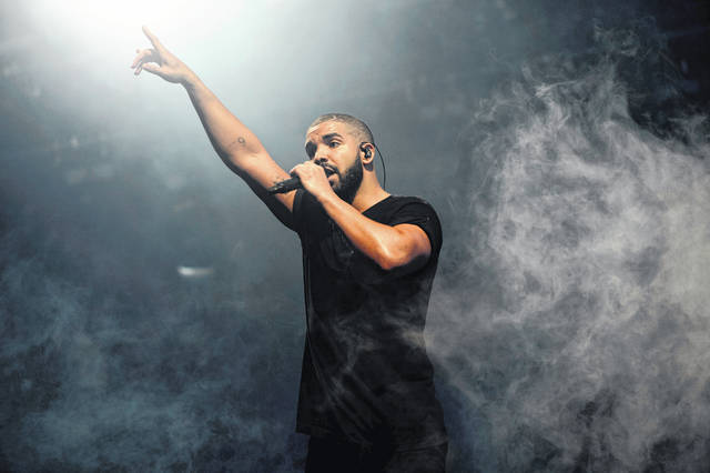 """Drake performs on the main stage at Wireless festival in Finsbury Park, London, in 2015. Drake landed his 208th song on the Billboard Hot 100 chart, setting a new record for most songs on the music chart. The rapper's latest track, """"Oprah's Bank Account"""" with DaBaby and Lil Yachty, debuted at No. 89 on the Hot 100 chart this week and helps Drake surpass the 207-song run the cast of """"Glee"""" held on the chart."""