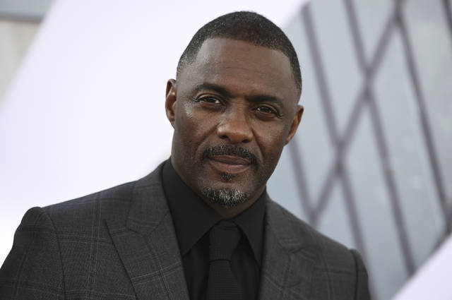 "FILE - In this July 13, 2019, file photo, Idris Elba arrives at the Los Angeles premiere of ""Fast & Furious Presents: Hobbs & Shaw."" Elba said in an Instagram post on Monday, March 16, 2020 that he has tested positive for the coronavirus and is isolating himself, but has shown no symptoms yet. (Photo by Jordan Strauss/Invision/AP, File)"