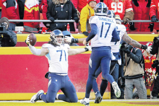 Tennessee Titans' Dennis Kelly (71) celebrates his touchdown catch with quarterback Ryan Tannehill (17) during the first half of the NFL AFC Championship football game against the Kansas City Chiefs Jan. 19 in Kansas City, MO.