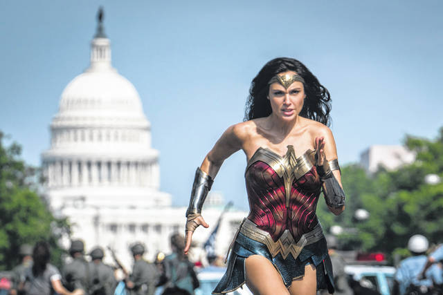 """Gal Gadot appears as Wonder Woman in a scene from """"Wonder Woman 1984."""" Warner Bros. on Tuesday delayed the summer release of the film to Aug. 14 instead of June 5 due to the coronavirus pandemic."""