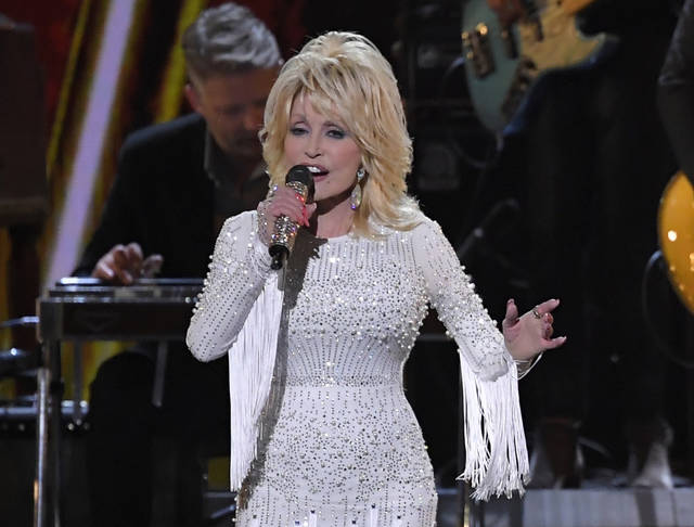 """FILE - This Nov. 13, 2019 file photo shows Dolly Parton performing at the 53rd annual CMA Awards in Nashville, Tenn. Parton's song, """"I Will Always Love You"""" is among 25 recordings being inducted to the National Recording Registry. (AP Photo/Mark J. Terrill, File)"""