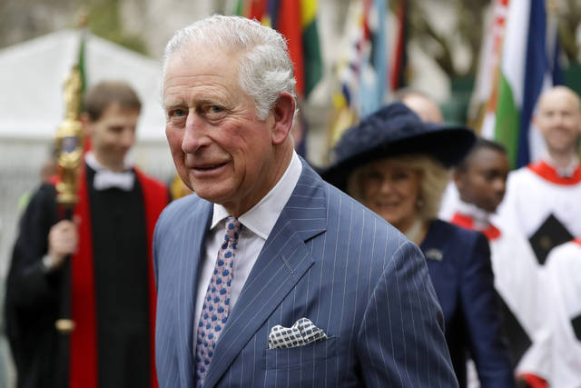 Britain's Prince Charles, 71, and Camilla the Duchess of Cornwall, in the background, leave after attending the annual Commonwealth Day service March 9 at Westminster Abbey in London. (AP Photo/Kirsty Wigglesworth, File)