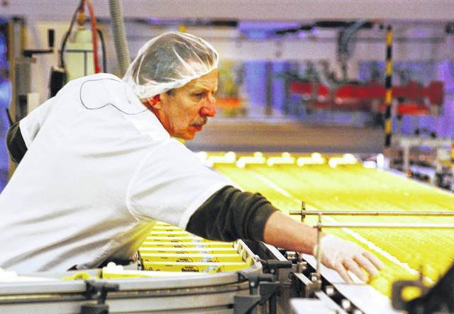 A worker at the Just Born factory in Bethlehem, Pa., keeps an eye on the marshmallow Peeps that pass by on the conveyor belt in April 2003. The Bethlehem, Pa.,-based Just Born confections company said its production facilities there and in Philadelphia closed Wednesday through April 7. The company says it had already produced and shipped the Easter supply of its signature marshmallow confection to outlets.
