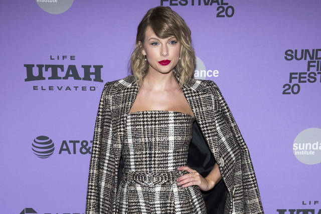 """Taylor Swift arrives at the premiere of """"Taylor Swift: Miss Americana"""" in January in Park City, Utah. Swift is helping fill the blank space where incomes have gone for several of her fans. Ten people so far have gotten thousands of dollars from the """"Lover"""" and """"1989"""" hit-maker."""