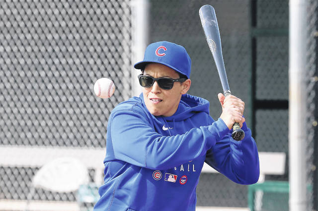 Chicago Cubs minor league hitting coach Rachel Folden hits infield ground balls at the Cubs spring trainng facility in Mesa, Ariz., Feb. 5, 2020.Folden figured something out early on during her first spring training with the Chicago Cubs — long before the coronavirus pandemic wiped out team activities. None of the players care all that much that one of their coaches is a woman. (John Antonoff/Chicago Sun-Times via AP)