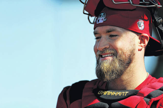 Cincinnati Reds catcher Tucker Barnhart (16) smiles following a bullpen session during spring training baseball, Friday, Feb. 14, 2020, at the Cincinnati Reds Spring Training Facility in Goodyear, Ariz. (Kareem Elgazzar/The Cincinnati Enquirer via AP)