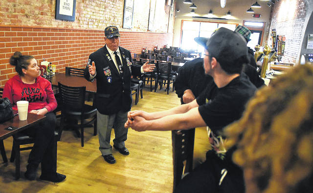Ray Magnus, owner of the 318 bar and restaurant in downtown Lima, held a staff meeting with employee's on Monday morning. Craig J. Orosz | The Lima News