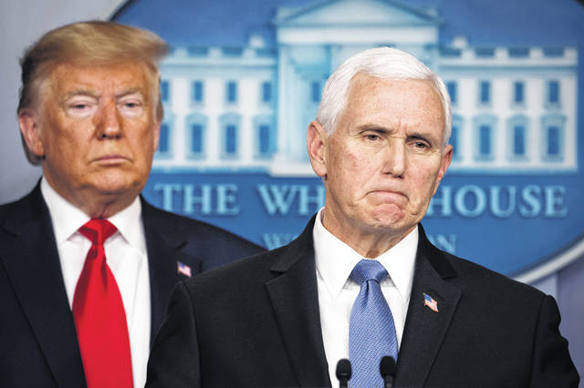Vice President Mike Pence, joined by President Donald Trump, pauses while speaking about coronavirus at the White House in Washington, Saturday, Feb. 29, 2020.