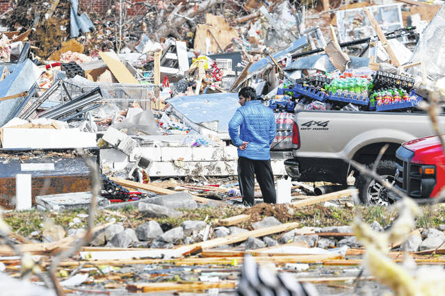 A man looks for items he can salvage from his store Tuesday, March 3, 2020, near Cookeville, Tenn. Tornadoes ripped across Tennessee early Tuesday, shredding more than 140 buildings and burying people in piles of rubble and wrecked basements. At least 22 people were killed.