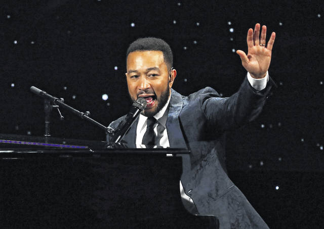 FILE - This March 5, 2020 file photo shows John Legend performing at The Alliance for Children's Rights 28th Annual Dinner in Beverly Hills, Calif. The spreading coronavirus might have canceled several touring performances from A-list musical artists, but those acts have found a new venue to sing: their living rooms. Legend, Bono, Coldplay's Chris Martin, Pink, John Mayer, Keith Urban and more have held virtual concerts from their homes as the world continues to practice social distancing to slow the spread of the virus.