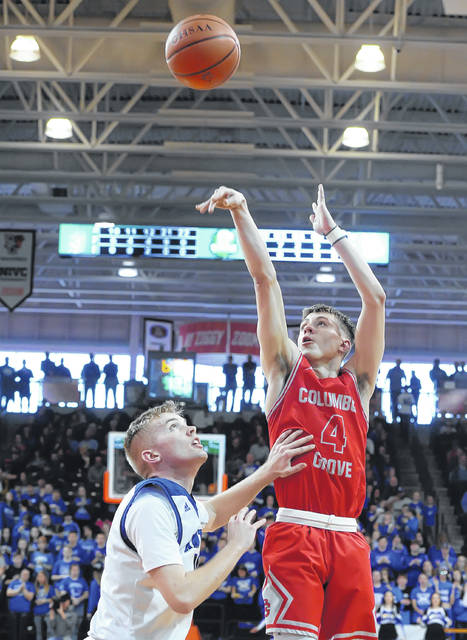 Columbus Grove's Evan Hopkins puts up a shot against Antwerp's Luke Krouse during a Tuesday night Division IV regional semifinal at the Stroh Center in Bowling Green.