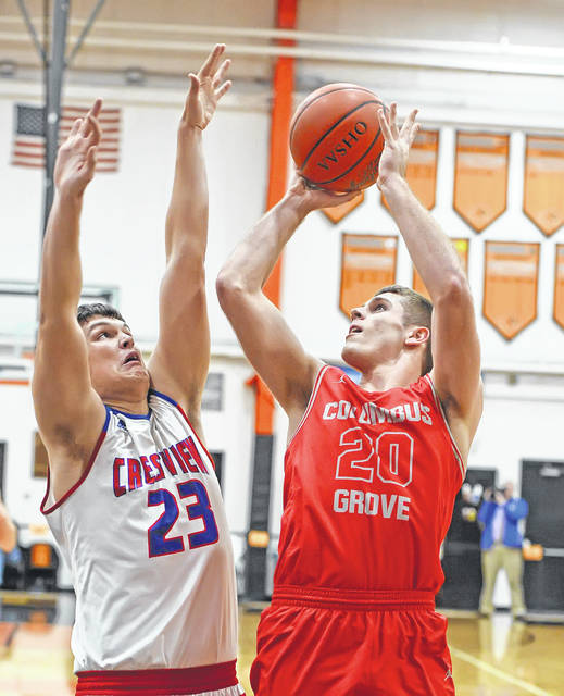 Columbus Grove's Ethan Halker puts up a shot against Crestview's Carson Kreischer during a Tuesday night Division IV district semifinal at the Elida Fieldhouse.