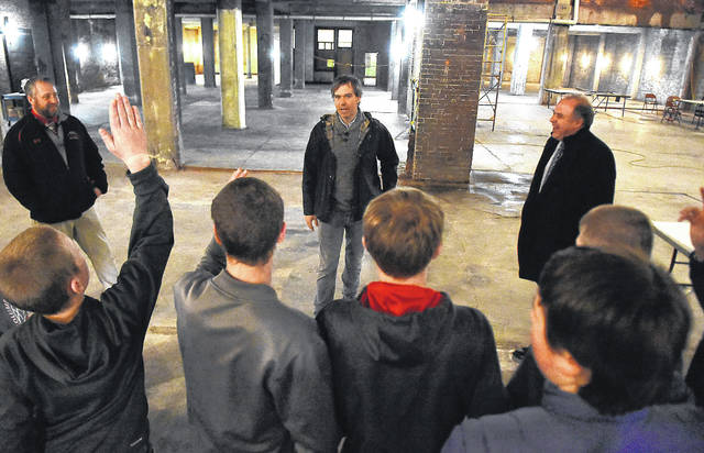Rob Nelson, owner of The Met in downtown Lima, takes questions from the Columbus Grove Economic Development students during a tour of his new brewery project in Lima.
