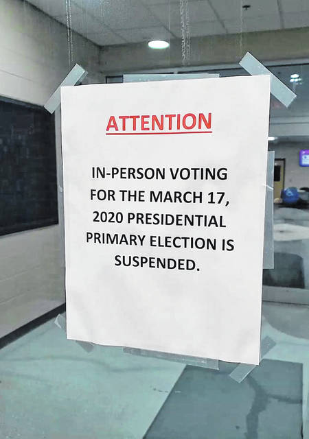 A sign tells would-be voters at the Putnam County YMCA in Ottawa about the postponement of Tuesday's primary election amid fears of coronavirus spreading.