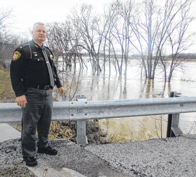Brian Siefker, Putnam County sheriff, assesses the Blanchard River Friday afternoon. It was expected to not cause any flooding but the wet spring season is just beginning.