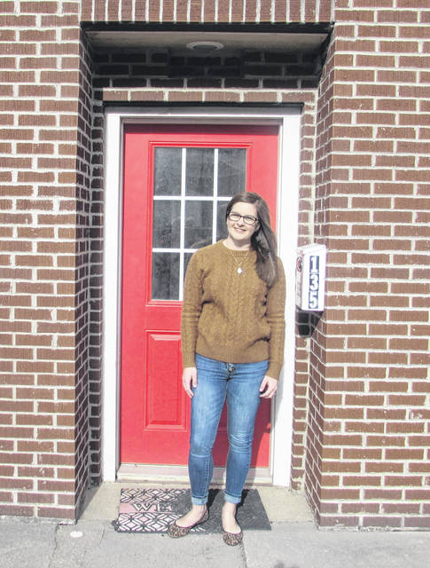 Stacey Benton is pictured outside The Fun Company in Leipsic, where she will serve as store manager.