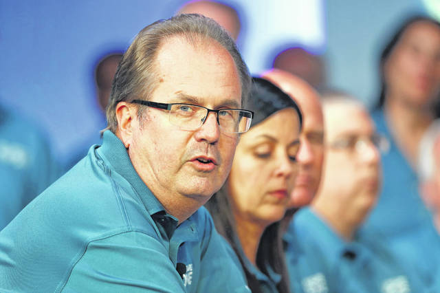 Gary Jones is shown a year ago during the opening of UAW contract talks with Fiat Chrysler Automobiles in Auburn Hills, Mich. Federal prosecutors have charged the former president of the United Auto Workers with corruption, alleging he conspired with others at the union to embezzle more than $1 million. Jones quit his post in November 2019. (AP Photo/Paul Sancya, File)