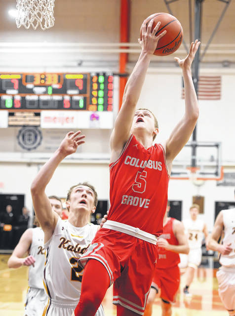Columbus Grove's Gabe Clement puts up a shot against Kalida's Zach VonderEmbse during Friday night's Division IV district final at the Elida Fieldhouse.