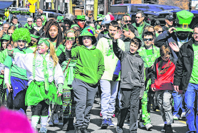 Students from St. Gerard Catholic School march in the 2018 Lima Irish Parade.