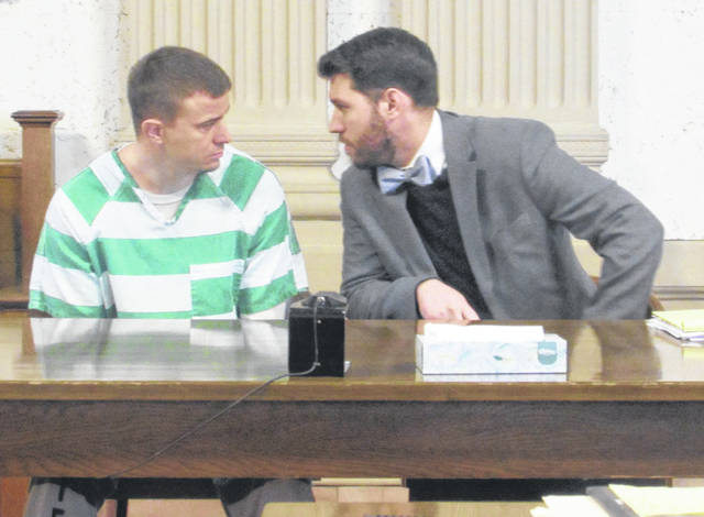 James Phillips, who was sentenced on aggravated robbery and kidnapping charges Monday in Putnam County, speaks with his attorney, Chris Woodworth.