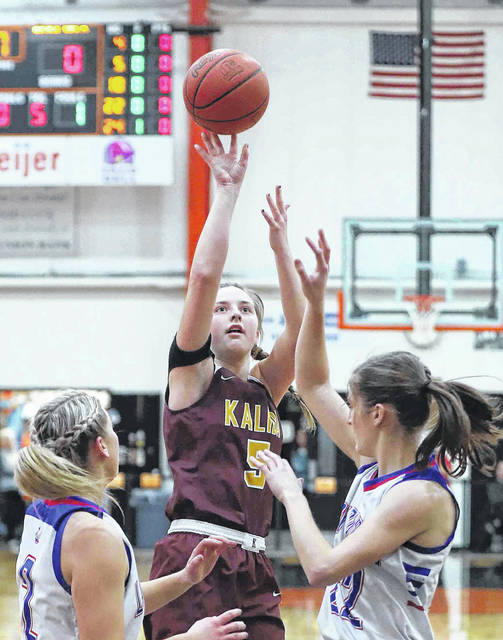 Kalida's Grace Klausing puts up a shot against Wayne Trace's Claire Sinn, left, and Rachel Stoller during a Thursday night Division IV regional semifinal at the Elida Fieldhouse.
