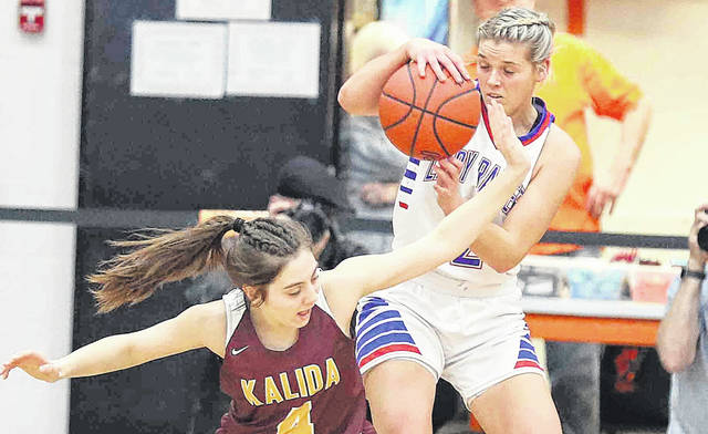 Kalida's Kathryn Siebeneck attempts to get the ball away from Wayne Trace's Claire Sinn during a Thursday night Division IV regional semifinal at the Elida Fieldhouse.