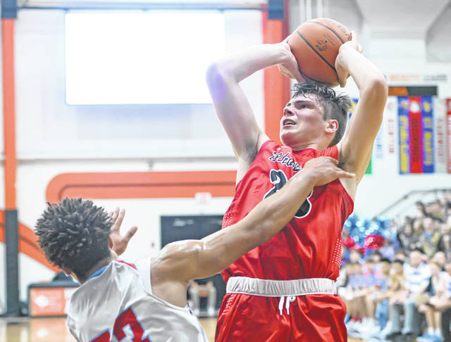 Shawnee's George Mangas, here putting up a shot against Lima Central Catholic's Shaun Thomas, during the Mercy Health Tip Off Classic at the Elida Fieldhouse in November, has been named the Division II player of the year by the Ohio Prep Sportswriters Association.