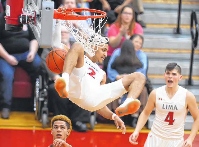 Lima Senior's Josiah Fulcher, here scoring on a dunk in a January game against Elida at Lima Senior, has been named to the Division I first team by the Ohio Prep Sportswriters Association.