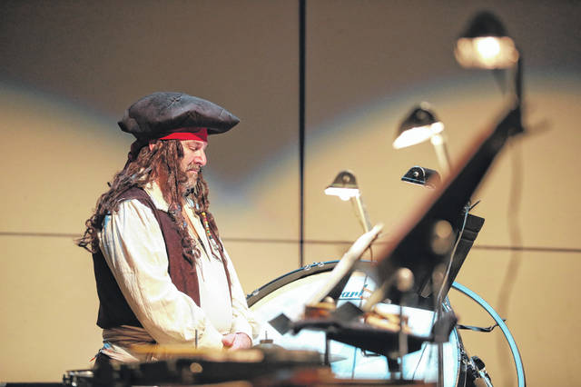 Tim Mattis on percussions during the Lima Symphony Orchestra Family Concert held at the Veterans Memorial Civic Centeron Sunday afternoon. Amanda Wilson -The Lima News
