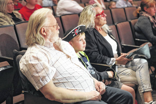 Roman Staley, 8, of DeGraff and his grandparents enjoying front row seats to the Lima Symphony Orchestra Family Concert held at the Veterans Memorial Civic Centeron Sunday afternoon. Amanda Wilson |The Lima News